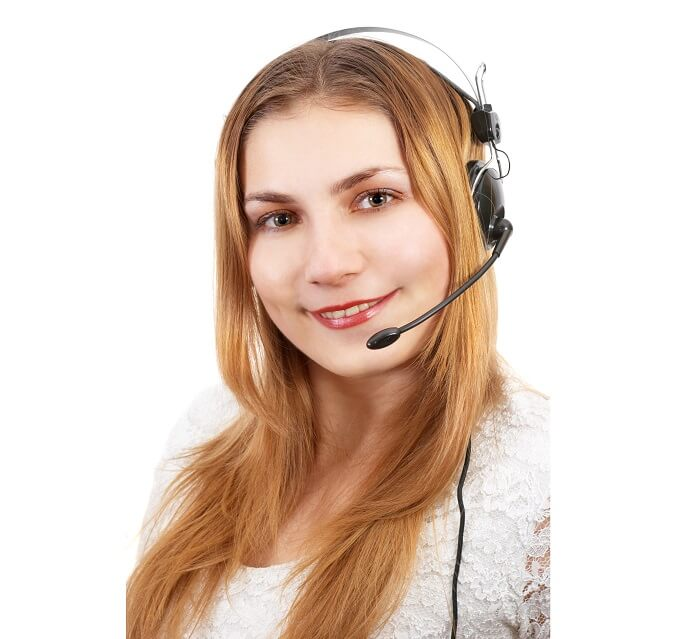 cute techsupport girl on the phone using headset
